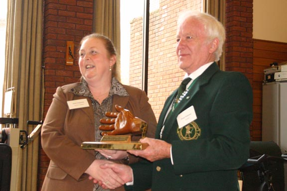 Kath receiving the Helping Hand Award from GNAS president Dennis Whiteman. Photo by Mick Fitzpatrick